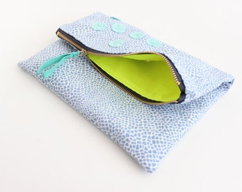 Blue and white geometric print with mint fold over clutch