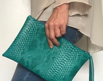 Green turquoise clutch in faux leather effect dragon with tassel.