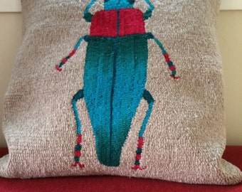 Turquoise beetle pillow