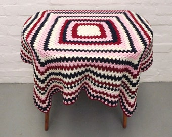 Vintage crochet blanket in blue, red and pink
