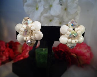 Vintage White Floral Earrings w/AB Crystals as Accents. The Rest of the Earrings are White Plastic. Set in Silvertone Metal.