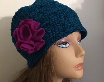 Teal blue chenille yarn skull hat winter warm Earth tone with a large fuchsia colored wool felt flower hand crocheted by mcleodhandcraftgift