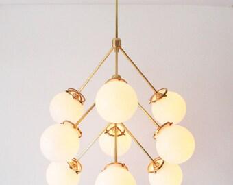 Modern Brass Chandelier, 9 White Glass Globes, Statement Chandelier Lighting Fixture, BootsNGus Lighting and Home Decor