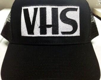 VHS trucker cap video cassettes