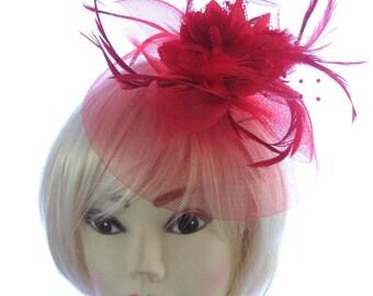 Red fascinator on a headband ,Ascot, races, Weddings