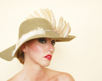 "The Pearl"" : wide brim felt hat with taxidermy wing"