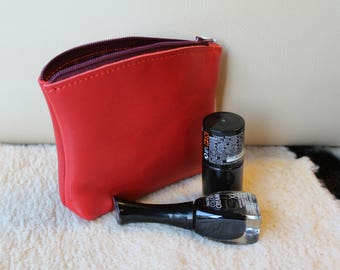 Kit in red leather clutch