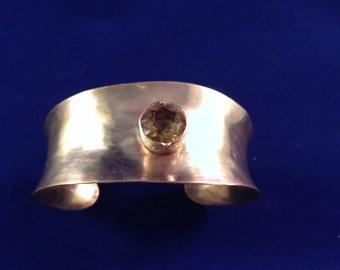 Brass cuff with golden quartz