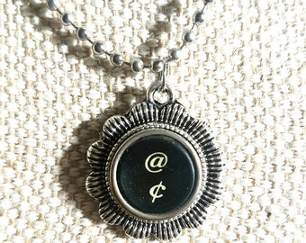 Black @ and cents symbol necklace with flower surround/ typewriter key pendant / silvertone flower pendant