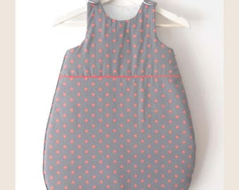 Gray sleeping bag with orange dots on order
