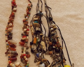 Two multi statement pendant necklaces, vintage heavy necklaces one of beads and one of suede with charms beads cabachons