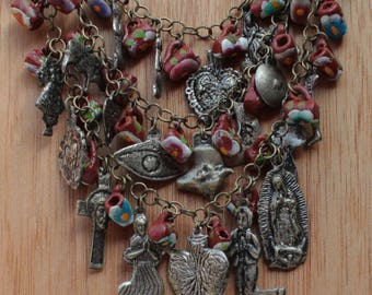 Mexican Milagro necklace - silver colored milagros and handmade clay pots