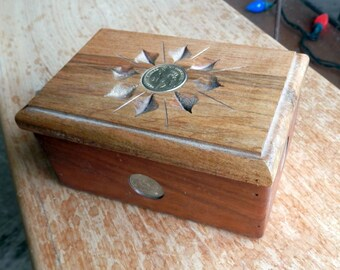 hand carved stash box with US coins inlaid in box cherry