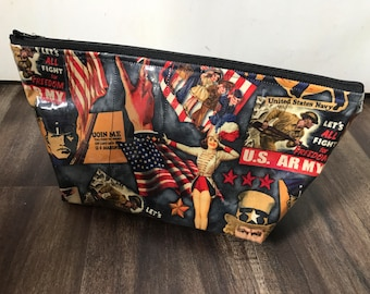 Zippered makeup bag in a retro US Army fabric with clear vinyl top layer