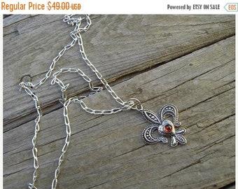 ON SALE Fleur de lis necklace in sterling silver with a garnet