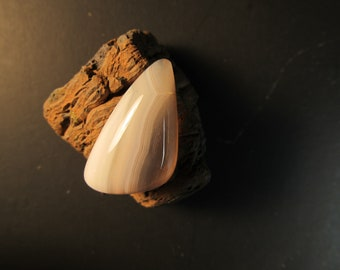 Brazilian Agate, free form cabochon, clear, white, with stripes in center
