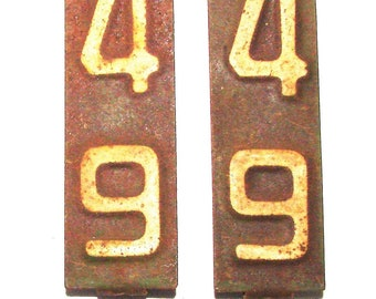 1949 Validation Tags License Plate With All 4 Tabs In Place On The Back Side