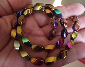 5 GOLD TWIST HEMATITE BEADS. COLORFUL 6 X 12 MM.