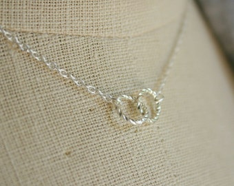 Sterling silver necklace with twisted rings