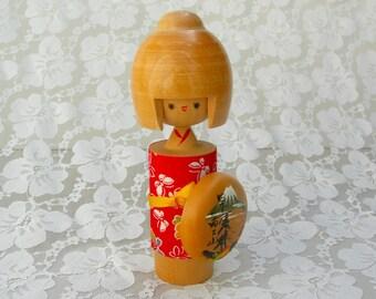 "Kawaii (Cute) Japanese Kokeshi, 7"" contemporary wood doll, red chirimen (crepe) fabric, Mt. Fuji shield, kawaii girl"