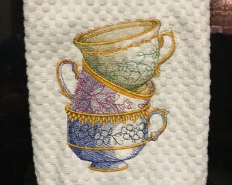 Dishtowel with ornate stacked teacups
