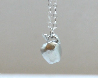 Apple with silver necklace