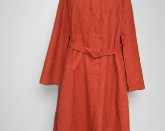 Rust  wool coat with cape-like sleeves from the 1970's