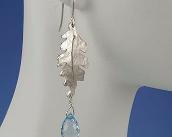 On SALE 20 to 50% off. Sterling silver oak leaves earrings with sky blue topaz