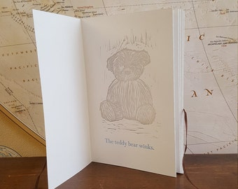 Letterpress Children's Book with Bear and Ribbon on Paper
