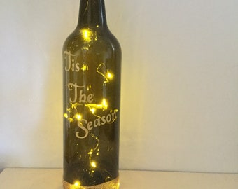 Glass wine bottle with lights, decorated, gift idea