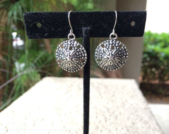 Silver tone silver dollar earrings