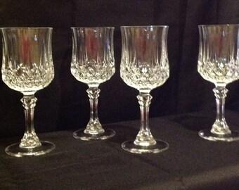 """A set of 4 Vintage Cris D'Arques, """"Longchamps"""" pattern, clear, 7 1/4"""" 8oz water goblets."""