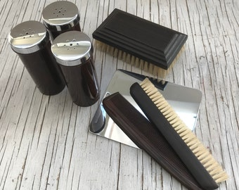 Collectable vintage valet set: 3 bakelite & chrome containers, large bristol brush, small brush, toothbrush, comb, metal mirror. No case.