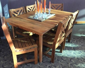 Oak top table with 6 solid teak chairs.
