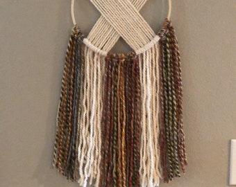 Handmade warth tone criss cross yarn wall hanging