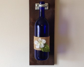 Wooden Wall Sconce and decorative wine bottle