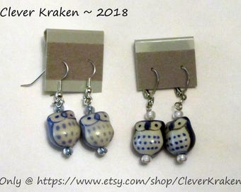 Owl Earrings, blue and white ceramic, with blue and white seed beads, on steel and silver colored findings, fishhook or lever back