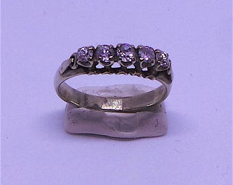 5 stone engagement/eternity ring in 18 carat gold