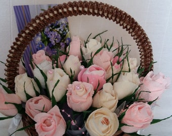 Handmade baskets with different kinds of flowers made from crep paper with candies in each flower
