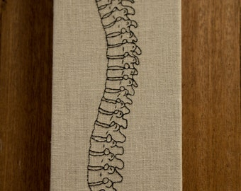 Hand embroidered spine