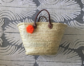 Handmade straw bag with genuine leather strap