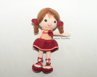 Art doll wearing a red dress with sneakers