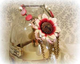 bLing in the liquor cabinet one of a kind vintage assemblage liquor label bottle necklace 1940 enamel flower chain miriam haskell pearl