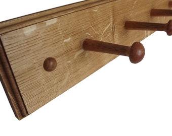 Wooden coat hooks in Oak in a shaker peg style
