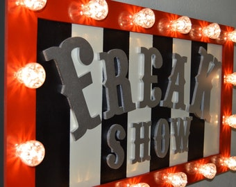 Freak Show Fairground Sign with Carnival Lights.