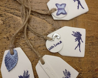 4 Clay fairy tags/gift tags/ party favours. 4 large luxury clay tags fairy design each with mini tag and space to write your own message.
