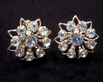 Lisner earrings, blue rhinestones, metal setting, Beautiful Mod Flower design. In wonderful condition. Mid Century Style. SALE PRICE!