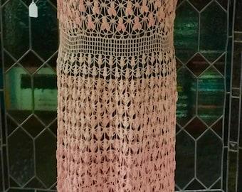 A light pink,peach dress in hand crochet circa 1935