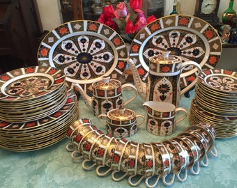 Royal Crown Derby Old Imari 1128 Dinnerware 12 Place setting. 78 pieces.