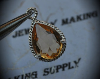 Silver Plated Rope Rim Bezel Brass Faceted Glass Tear Drop Pendant - Topaz